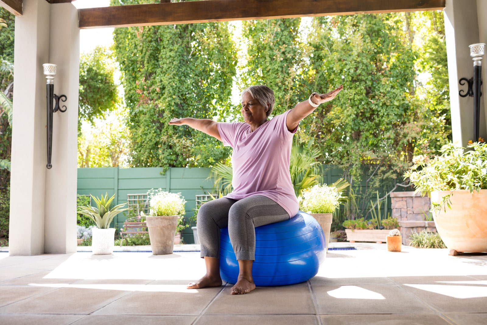 woman exercising in covered garden area